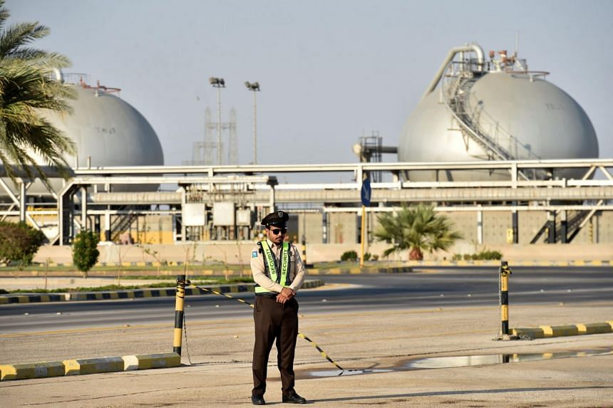 A security guard standing at the entrance of Saudi Arabia's Abqaiq oil processing plant, on Sept 20, 2019.