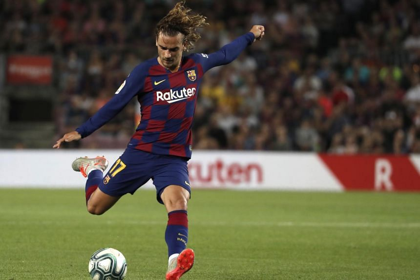 Barcelona's Antoine Griezmann kicks the ball during the Spanish La Liga soccer match between FC Barcelona and Valencia CF, on Sept 14, 2019.