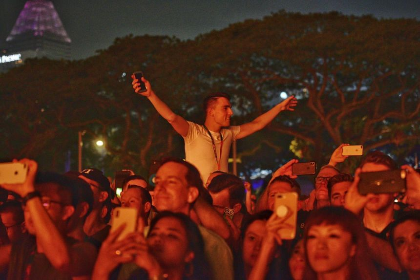Fans enjoying the music during the performance of Swedish House Mafia.
