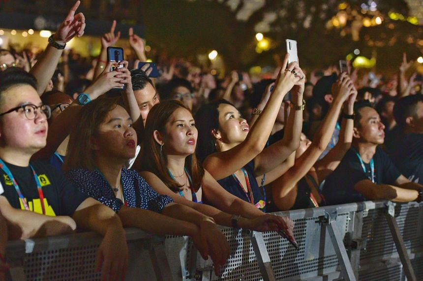 Fans enjoying the music during the performance of Swedish House Mafia.