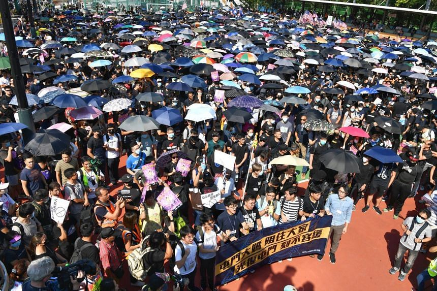 Protesters start their march from San Wo Lane playground in Hong Kong's Tuen Mun district on Sept 21, 2019.