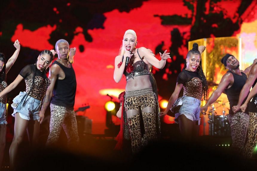 F1 Singapore: Gwen Stefani signs tattoo for fan, brings personality