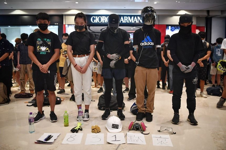 Protesters observing a minute of silence, for people they believe were killed at Prince Edward MTR station on Aug 31, at a mall in Hong Kong's Yuen Long district on Sept 21, 2019.