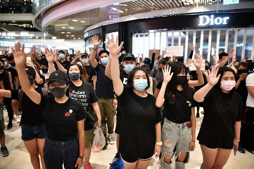 Protesters demonstrating for their five demands at a mall in Hong Kong's Yuen Long district on Sept 21, 2019.