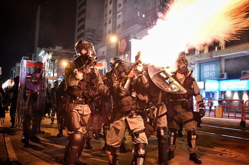 Police fired tear gas at residents as they retreated in castle peak road in Yuen Long.