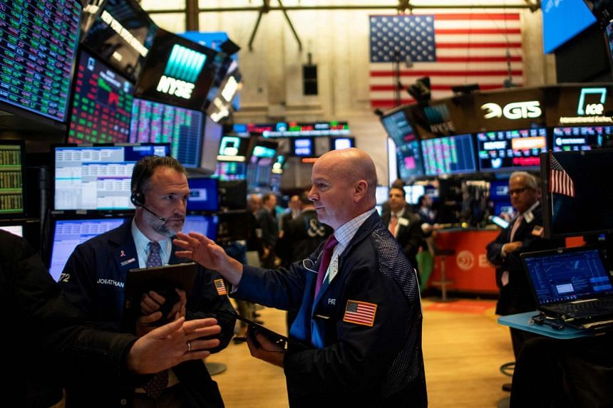 Traders work before the closing bell at the New York Stock Exchange.