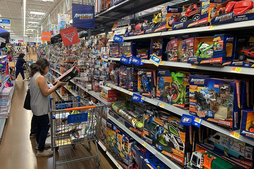 A shopper looking at made-in-China toys at a store in Los Angeles earlier this month. United States President Donald Trump has imposed tariffs on US$360 billion (S$495 billion) worth of Chinese goods and plans to tax nearly all imports from China by