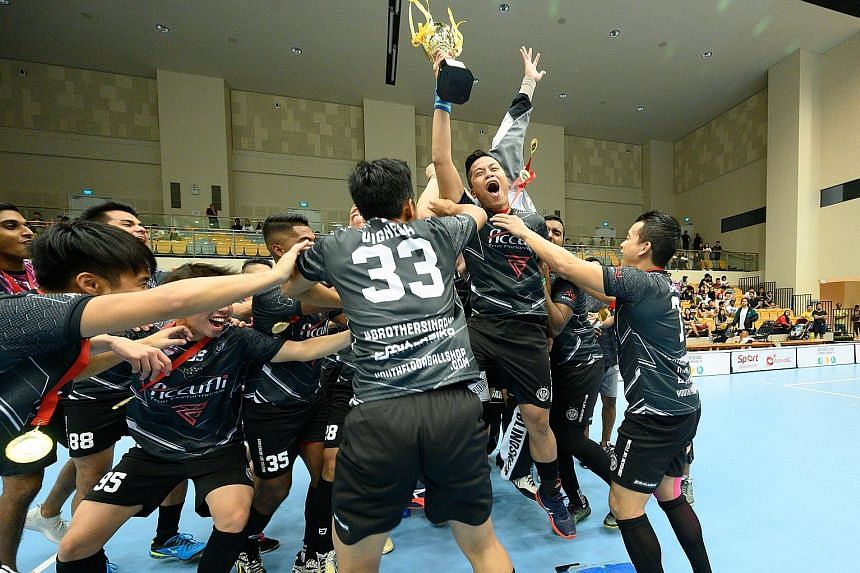 Black Wondersticks players celebrating after winning the ActiveSG-SFA Floorball Premier League men's play-offs yesterday at Our Tampines Hub. They beat Skools Innebandy 4-2 in the final, with national men's captain Syazni Ramlee netting two goals. In