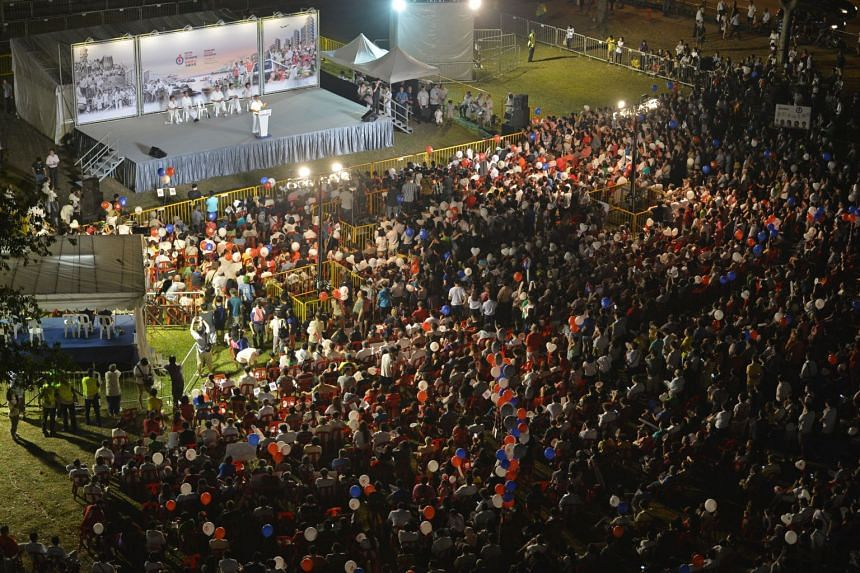In this picture taken on Sept 9, 2015, a crowd watches a People's Action Party rally for Jalan Besar GRC held at a field in Boon Keng Road.