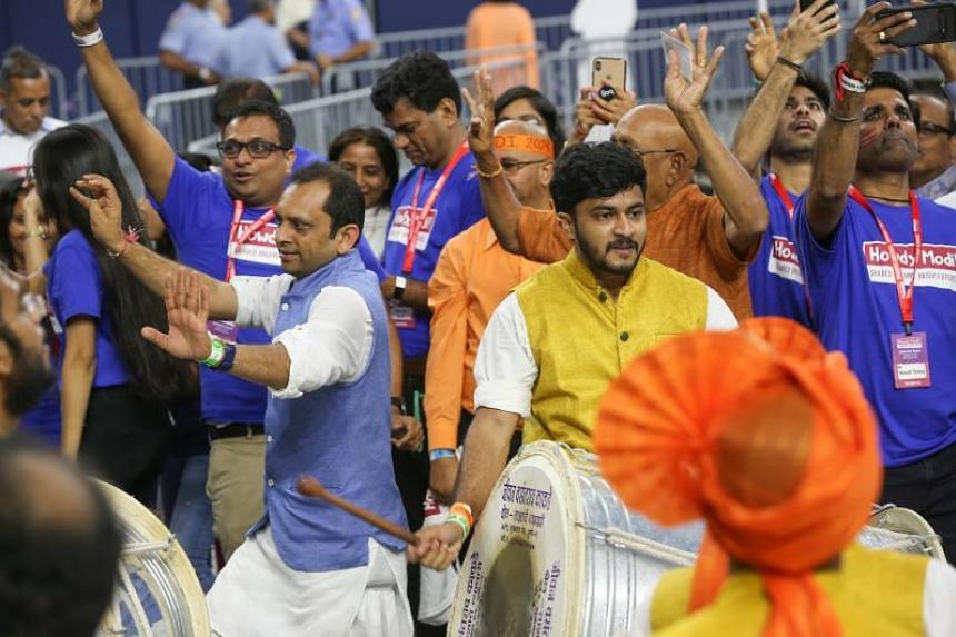 People dance as the Shivam Pathak drummers perform before Indian Prime Minister Modi speaks at the Community Summit on Sept 22, 2019 at NRG Stadium in Houston, Texas.