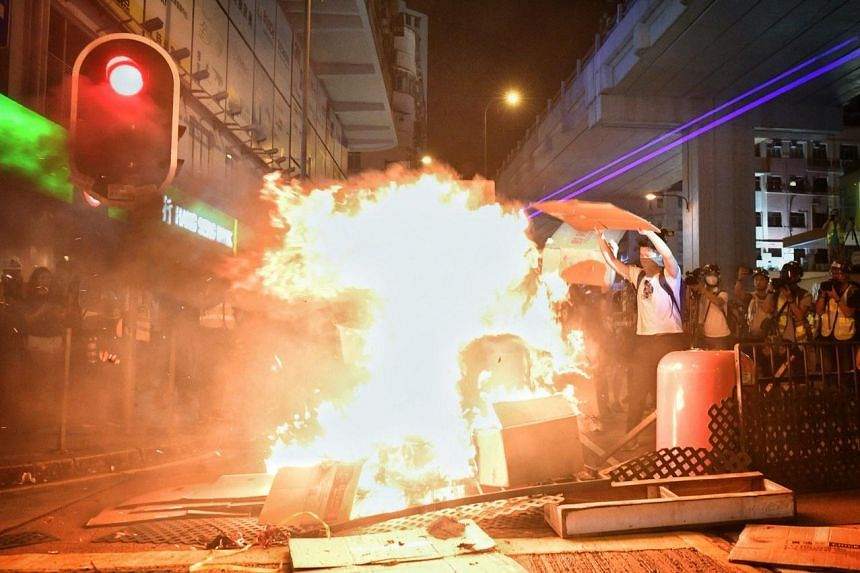 Protesters set Nathan Road on fire right outside Mong Kok police station, which is next to Prince Edward MTR Station, on Sept 22, 2019.