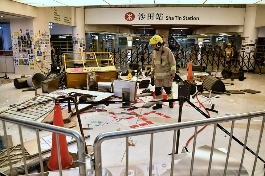 A fireman looking for hazardous materials from the blockage put up by the protesters inside New Town Plaza, Sha Tin on Sept 22, 2019.