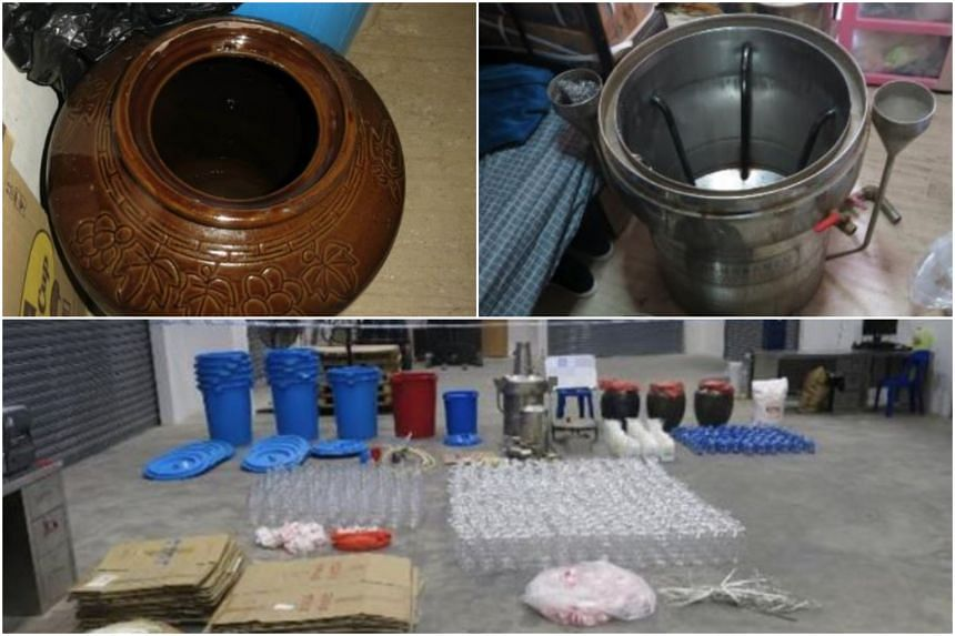 Officers seized one porcelain jar and nine bottles of contraband liquor with an estimated volume of 58 litres, and assorted manufacturing apparatus during a raid.