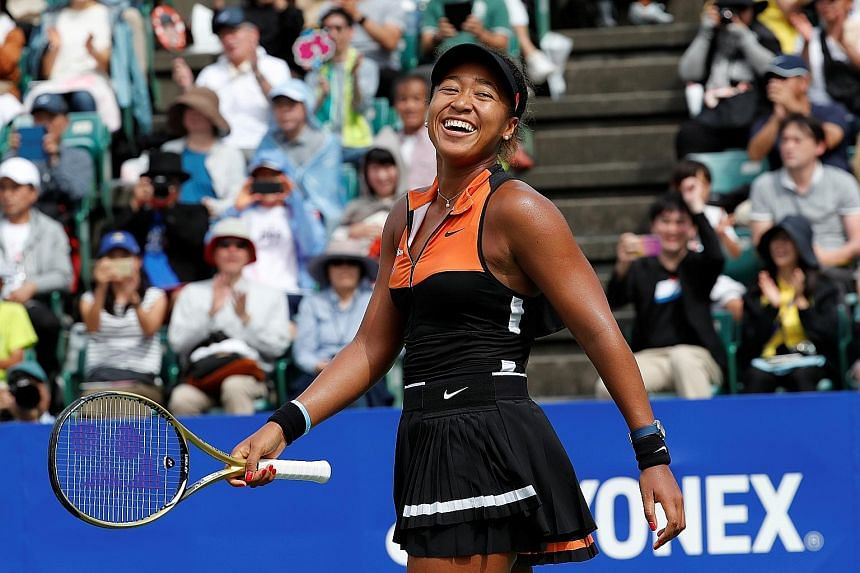 Naomi Osaka enjoying herself during her Pan Pacific Open victory over Anastasia Pavlyuchenkova. It is the Japanese's first title since the 2018 Australian Open.