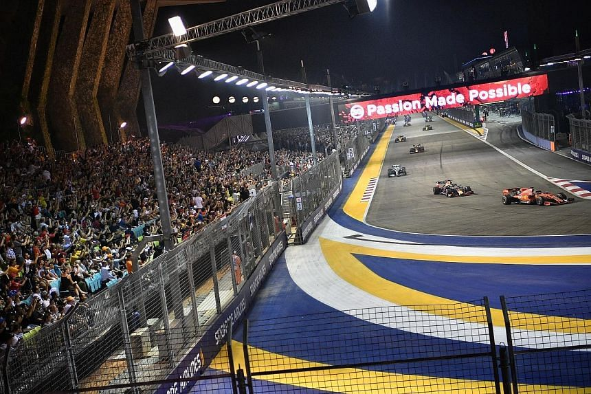 The crowd watching the action yesterday at the Singapore Airlines Singapore Grand Prix at the Marina Bay Street Circuit, which saw Sebastian Vettel thrilling fans with his victory. ST PHOTO: ARIFFIN JAMAR