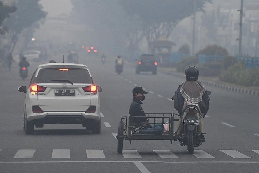 Haze shrouding Pekanbaru town on Saturday. The PM10 Pollutant Standards Index surged past 700 at 10pm yesterday, the highest it has ever reached, surpassing the pollution levels during Indonesia's worst haze episode in 2015. Riau, in the central part