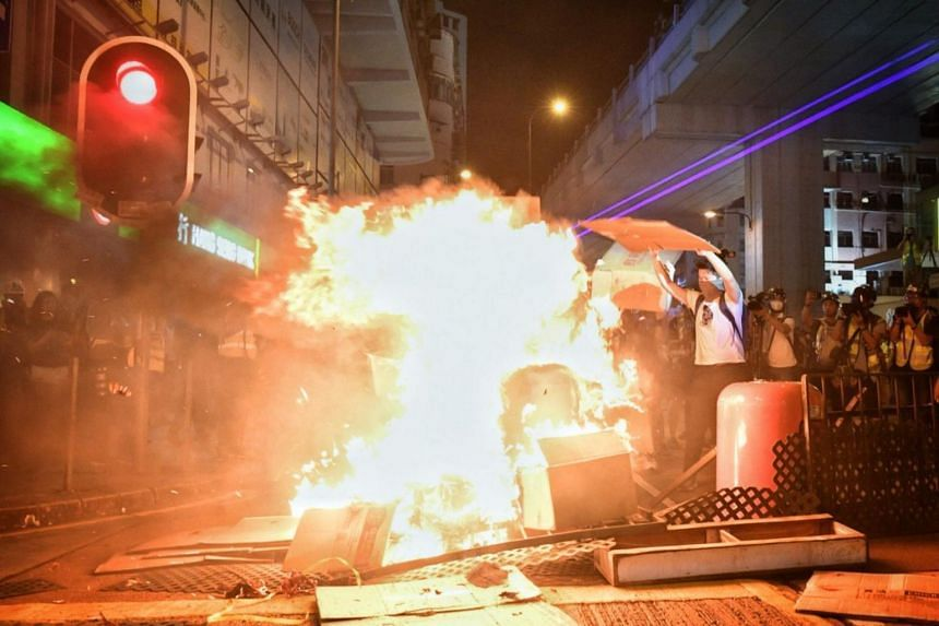 Protesters set Nathan Road on fire right outside Mong Kok police station, next to Prince Edward MTR Station in Hong Kong on Sept 22, 2019.