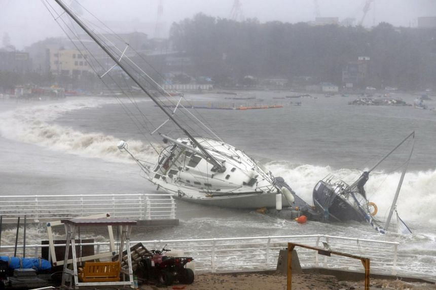 A yacht is pushed to shore by strong tides in Ulsan, South Korea on Sept 22, 2019 as Typhoon Tapah approaches the country.