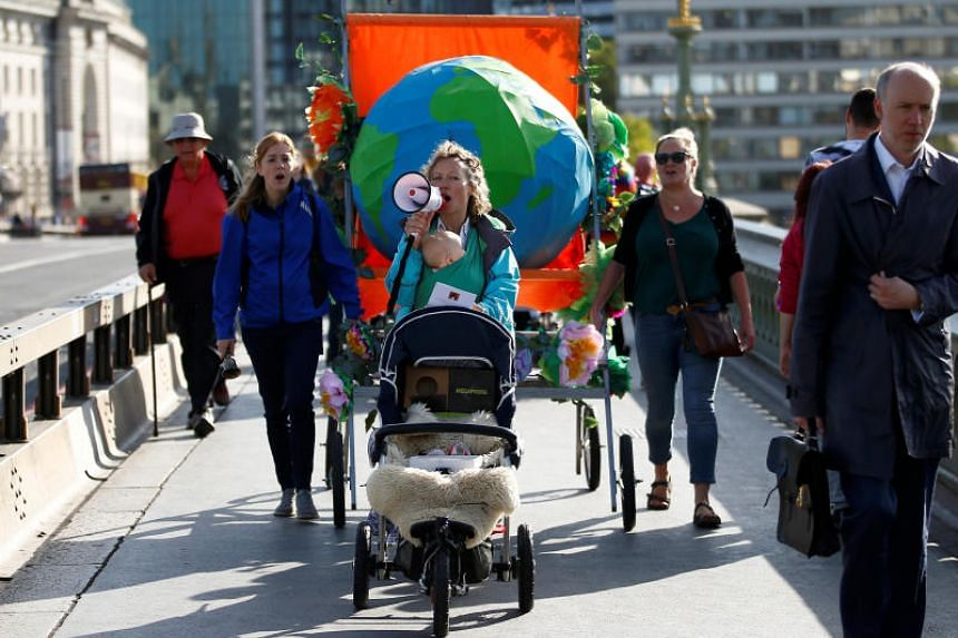 Mothers with prams protest on Westminster Bridge, ahead of the UN Climate Action Summit, in London on Sept 23, 2019.