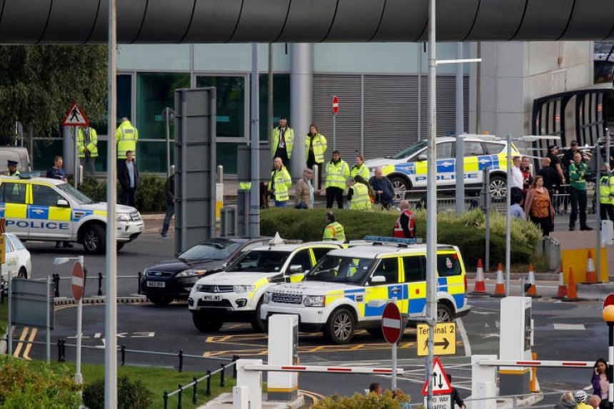 Police officers seen as a suspicious package was found at Manchester Airport on Sept 23, 2019.