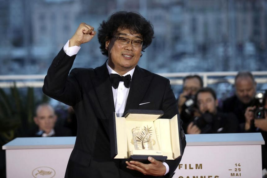 Director Bong Joon-ho with the Palme d'Or award for Parasite during a photo call following the awards ceremony at the 72nd international film festival, Cannes on May 25, 2019.