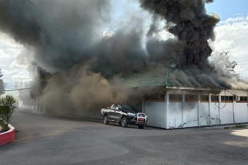 A building burns as fresh protests break out in Wamena, Papua, on Sept 23, 2019.