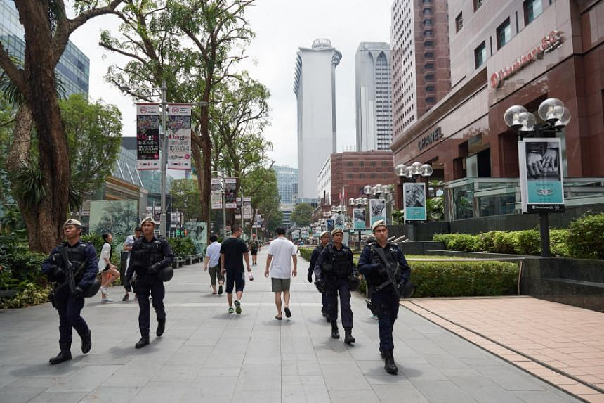 A photo taken on Feb 17, 2018, shows the police's In-Situ Reaction Team officers patrolling in Orchard Road. The MHA said that ISIS continues to attract local and foreign supporters even though the terror group has lost much territory.