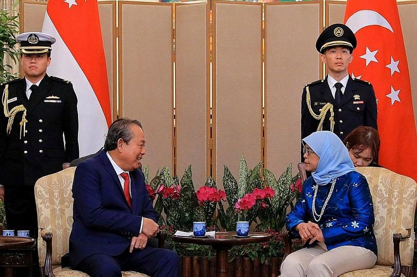 President Halimah Yacob and Vietnam's Permanent Deputy Prime Minister Truong Hoa Binh reaffirmed the excellent state of bilateral ties and had a good exchange on regional developments at the Istana yesterday.