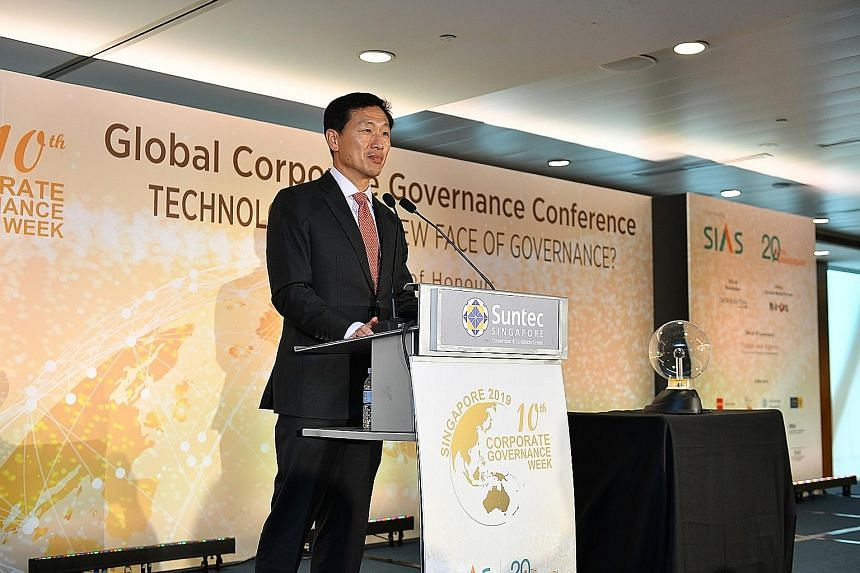 Education Minister Ong Ye Kung speaking at the start of the 10th annual Corporate Governance Week, held at Suntec Singapore Convention and Exhibition Centre yesterday.
