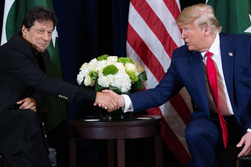 US President Donald Trump shakes hands with Pakistani Prime Minister Imran Khan (left) during a meeting on the sidelines of the UN General Assembly in New York on Sept 23, 2019.