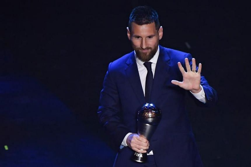 Argentina and Barcelona forward Lionel Messi reacts after winning the trophy for the Best FIFA Men's Player of 2019 Award in Milan on Sept 23, 2019.