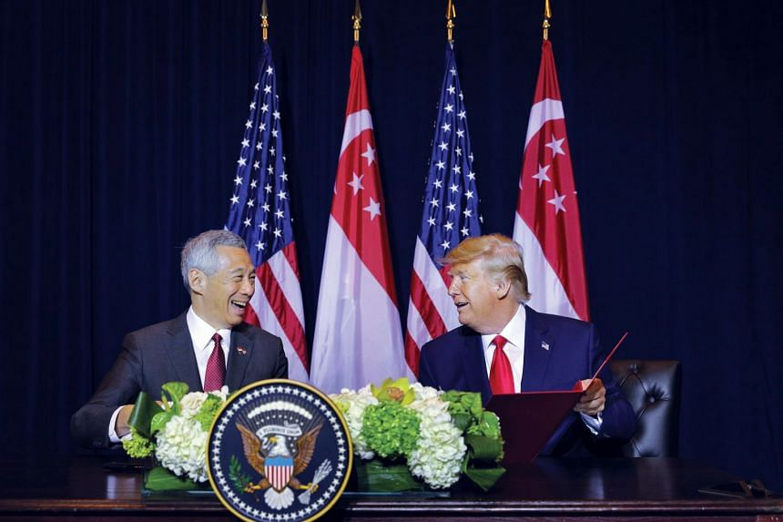Singapore Prime Minister Lee Hsien Loong and US President Donald Trump sign a memorandum of understanding at the Intercontinental New York Barclay in New York on Sept 23, 2019.