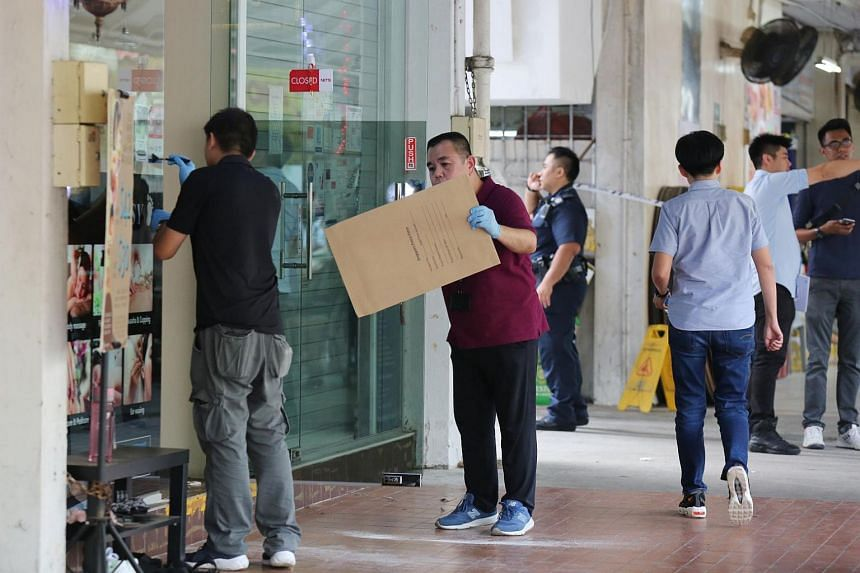 Police officers at the scene, on Sept 24, 2019. Officers from the Ang Mo Kio Police Division arrested the men after establishing their identities through closed-circuit television footage and inquiries on the ground.