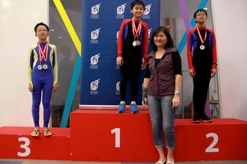 Alison Chan presenting medals at the 2014 national inter-school ice skating championships. Chan, the newly elected president of the Singapore Ice Skating Association, was previously the federation's secretary and later its vice-president.