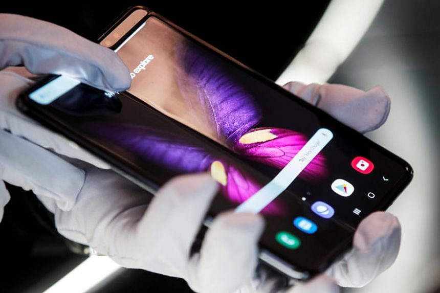 The Samsung Galaxy Fold 5G phone is presented at the hall of Samsung at the IFA consumer tech fair in Berlin on Sept 6, 2019.