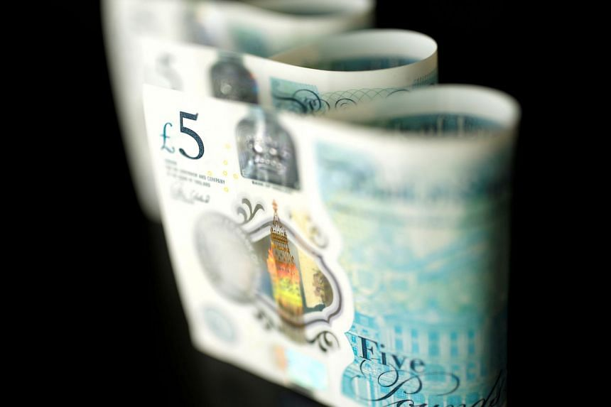 British five pound banknotes are seen in this picture illustration.