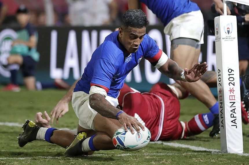 Rey Lee-lo scoring the fifth of Samoa's six tries in their 34-9 Pool A win over Russia in Kumagaya yesterday. He was one of two Samoan players sent to the sin bin for high tackles in the first half but his team recovered well from a 6-5 half-time def
