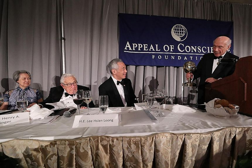 Prime Minister Lee Hsien Loong received the World Statesman Award from Rabbi Arthur Schneier, president and founder of the Appeal of Conscience Foundation, in New York on Monday. With him were Mrs Lee (from left) and former United States secretary of