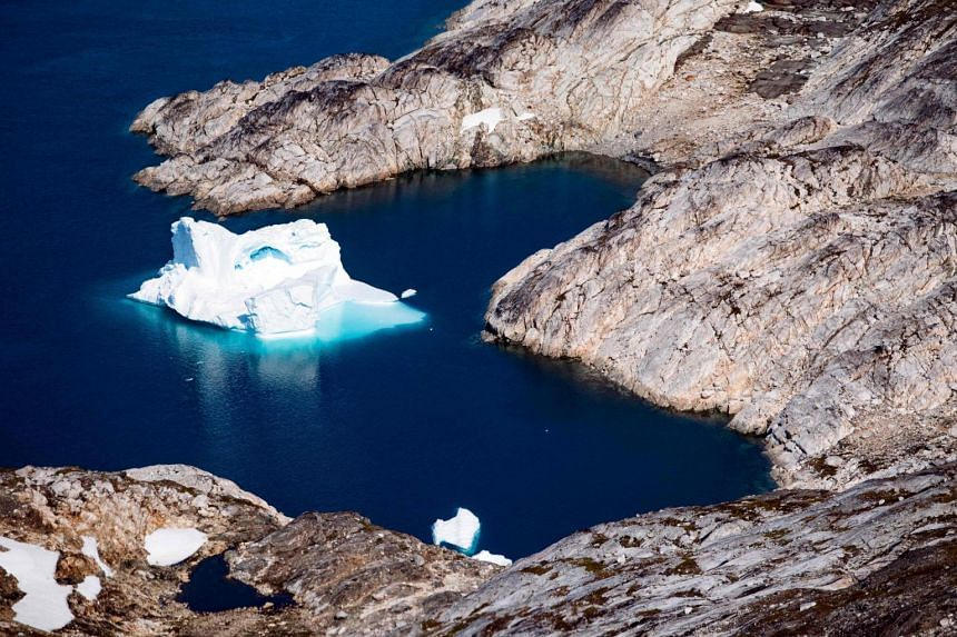 The report says ice loss from Greenland and Antarctic is speeding up and is expected to accelerate from mid-century, with sea levels continuing to rise for centuries.