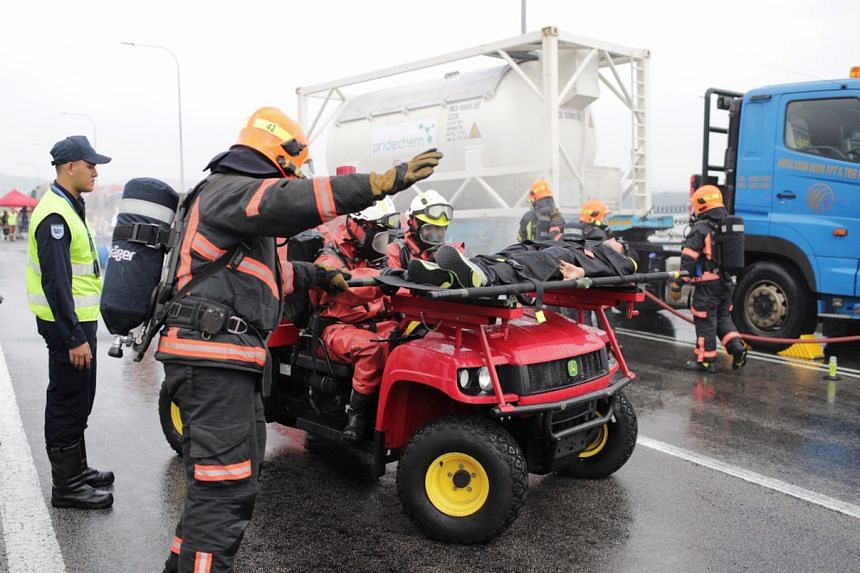 """The rescue team evacuating one of the """"casualties"""" from the accident scene at Tuas Second Link on Sept 25, 2019."""