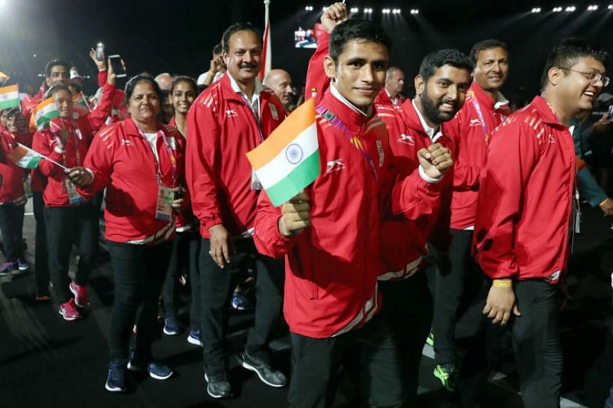In this file photo taken on April 15, 2018, Indian athletes attend the closing ceremony of the Gold Coast 2018 Commonwealth Games at the Carrara Stadium in Gold Coast, Australia.
