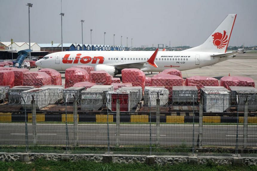 In a photo taken on March 15, 2019, a grounded Lion Air Boeing 737 Max 8 aircraft sits on the tarmac at Soekarno-Hatta International Airport in Cenkareng, Indonesia.