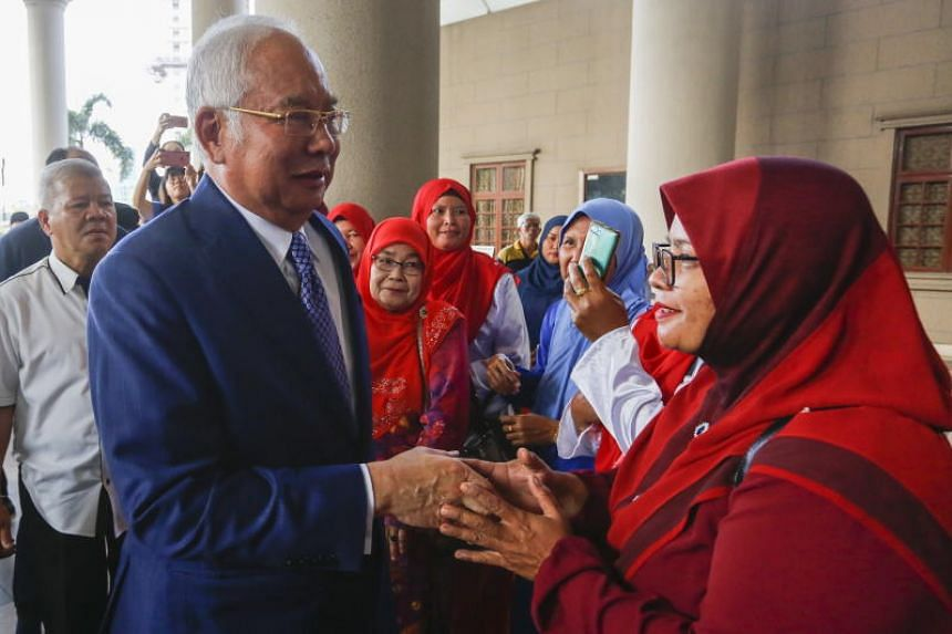 Former Malaysian prime minister Najib Razak is greeted by a supporter at the High Court in Kuala Lumpur on Sept 25, 2019.