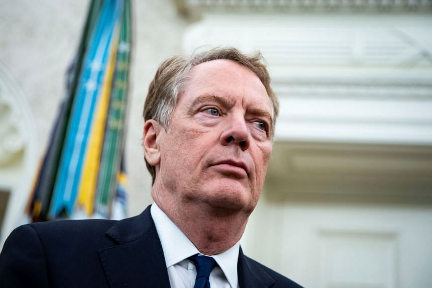 US Trade Representative Robert Lighthizer listens to US President Donald Trump at the White House.
