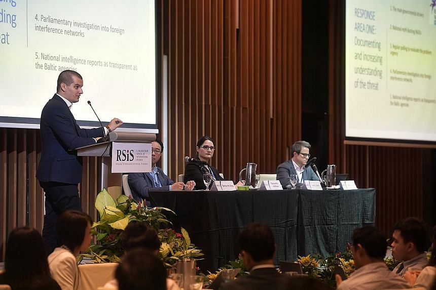 Mr Jakub Janda, director of the European Values Centre for Security Policy, giving a presentation during a panel discussion at the conference yesterday. Beside him are (from left) moderator and S. Rajaratnam School of International Studies senior fel