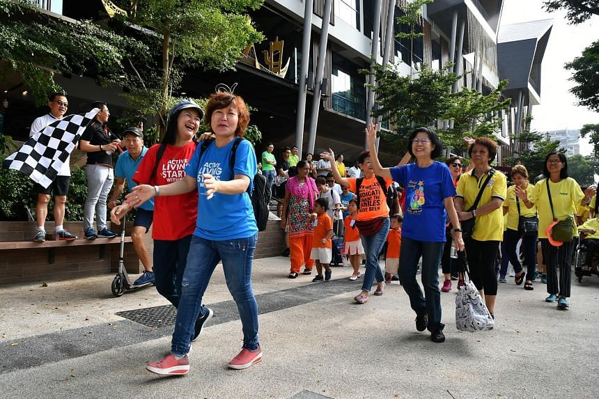 FairPrice chief executive Seah Kian Peng (left) and South East District Mayor Maliki Osman flagging off an activity in Wisma Geylang Serai for the FairPrice Walk for Rice+ @ South East campaign yesterday. Organisers aim to raise 500,000 bowls of whit