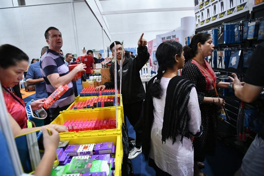 Participants at the Compressport booth after collecting their race packs.