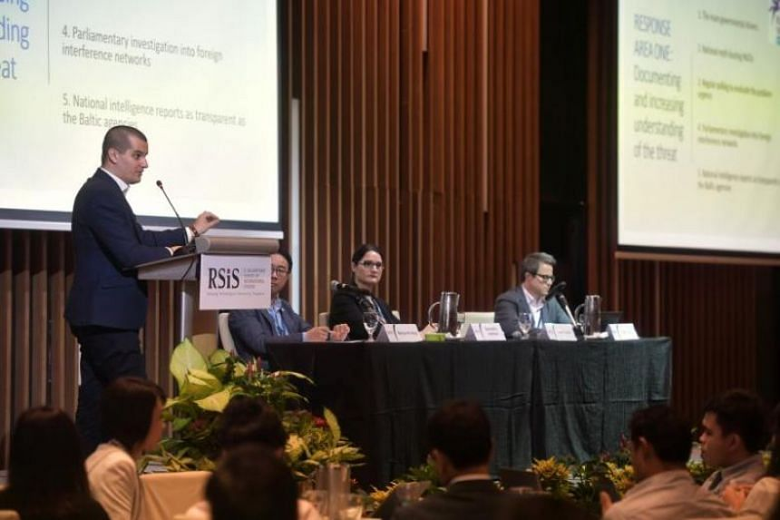 Panel members at the Conference on Foreign Interference Tactics and Countermeasures, held on Sept 25, 2019. The conference was organised by the Nanyang Technological University's S. Rajaratnam School of International Studies.