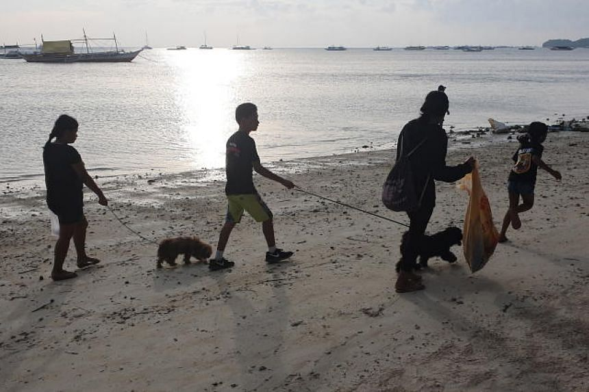 In a photo taken on Sept 21, volunteers collect garbage during the International Coastal Cleanup Day, in Boracay, the Philippines.