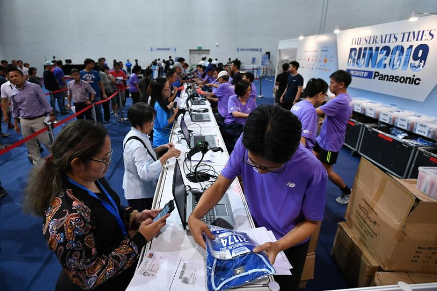 Participants of The Straits Times Run 2019 collecting their race packs during the ST Run race pack collection at OCBC Arena Hall 1 on Sept 26, 2019.
